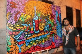 Alex-Mijares-with-his-artwork-600x400